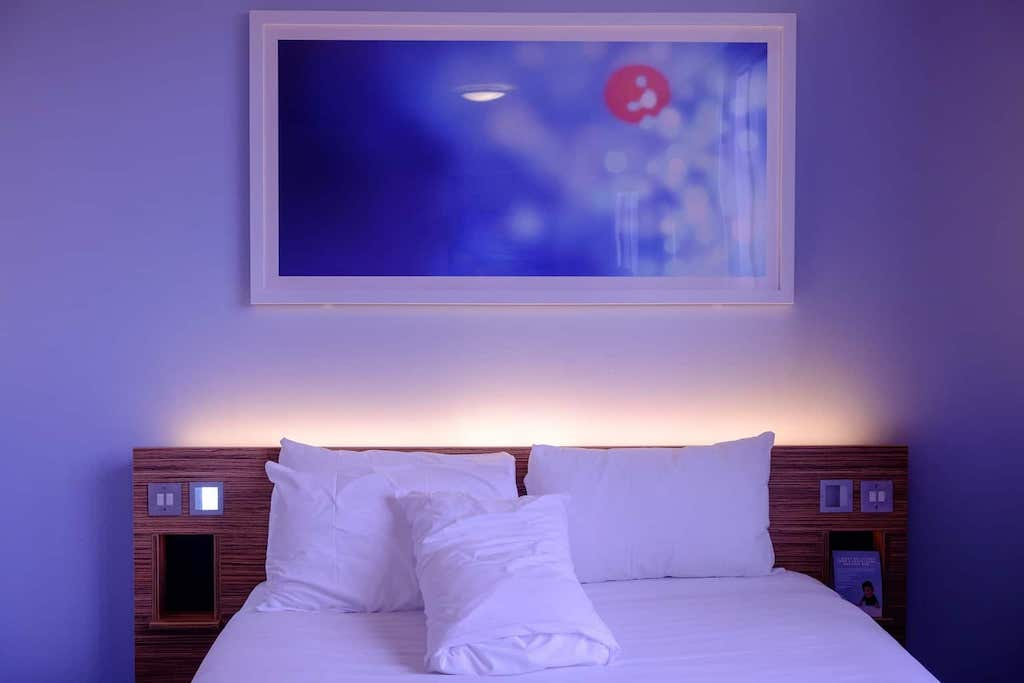 dark-bedroom-with-headboard-backlight-clean-sleeping-space-min