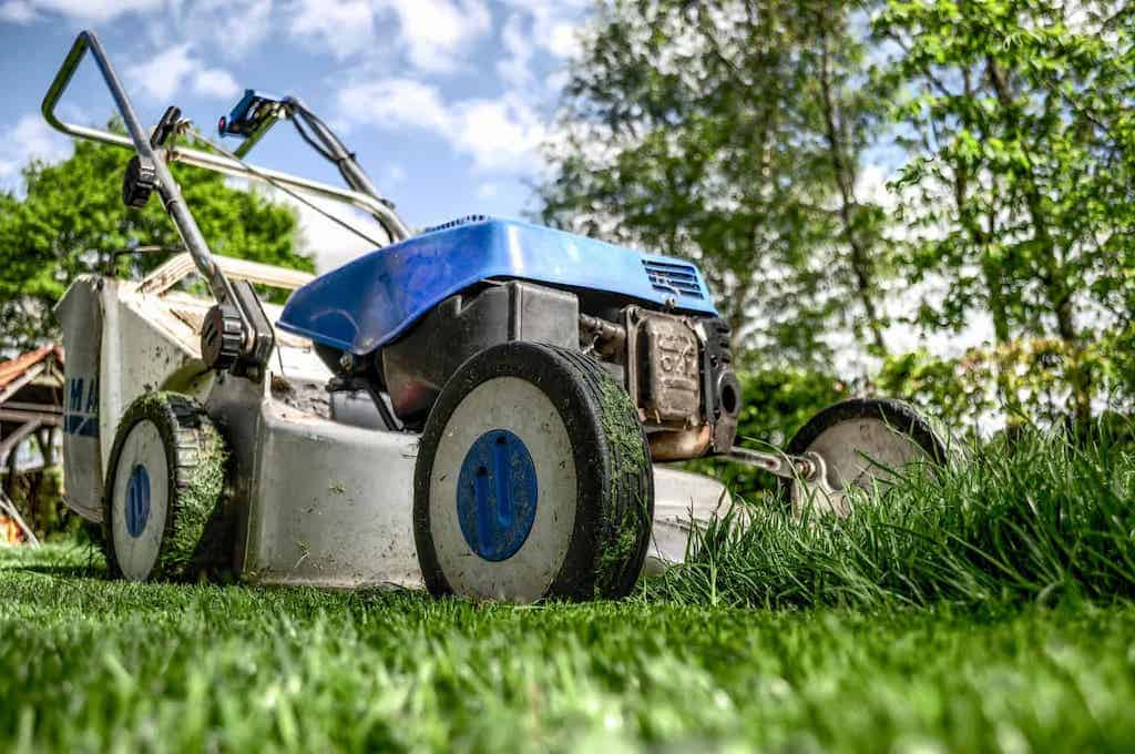 lawnmower in grass doing yardwork to get unstuck
