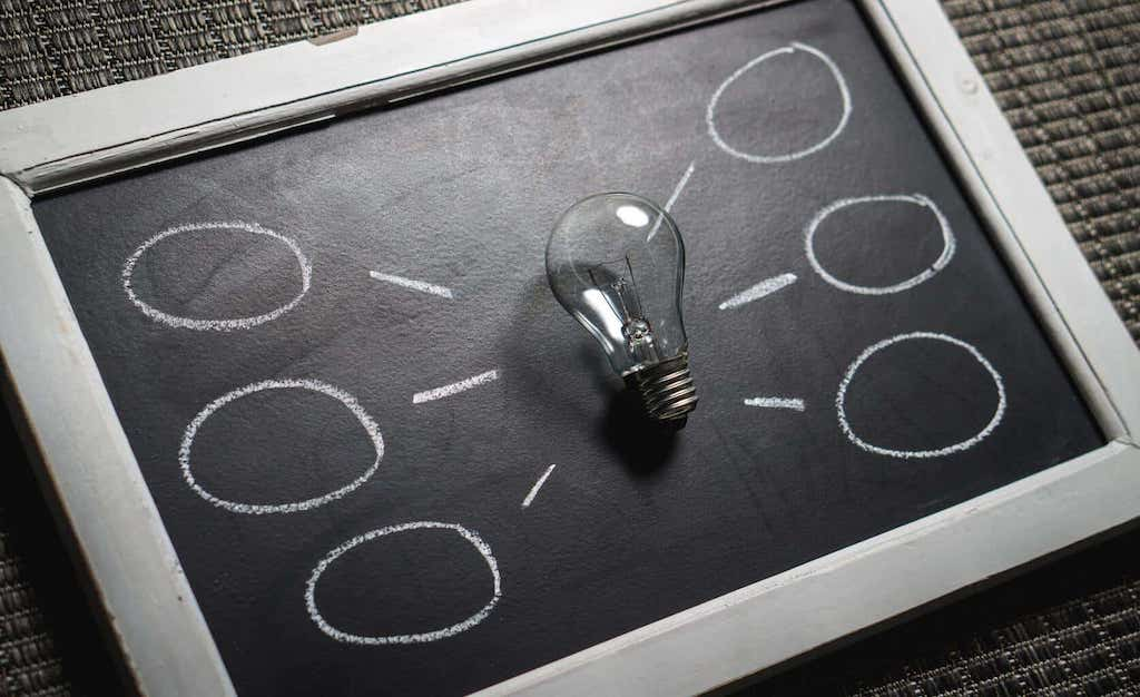 black and white chalkboard with light bulb