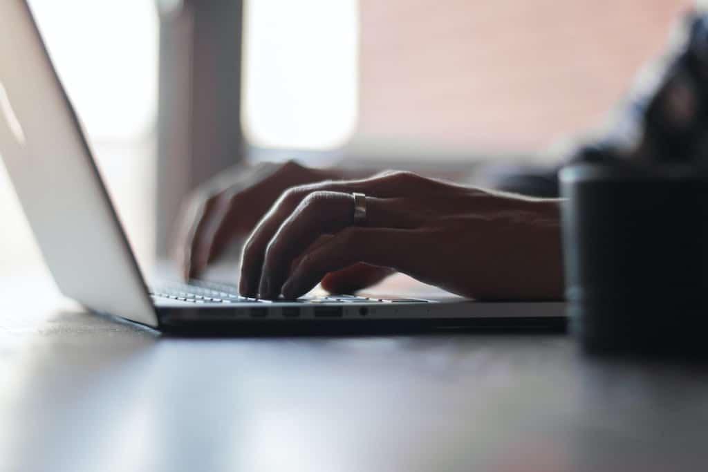 man working on a laptop start to blog min