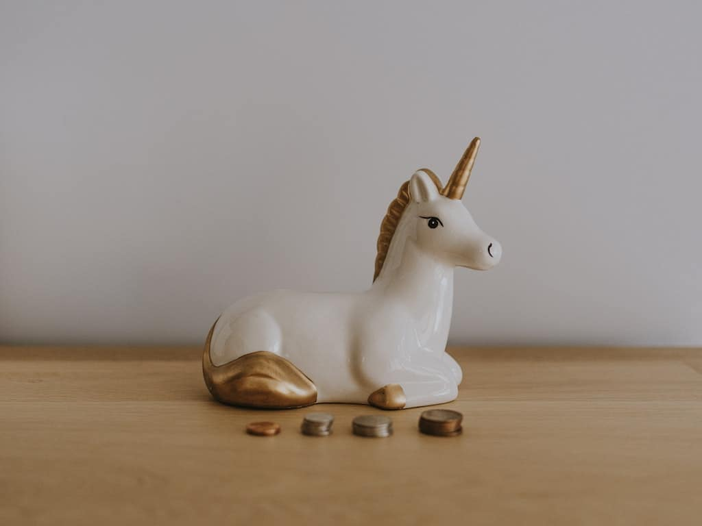 unicorn and stacks of coins representing the hard to find best savings account min